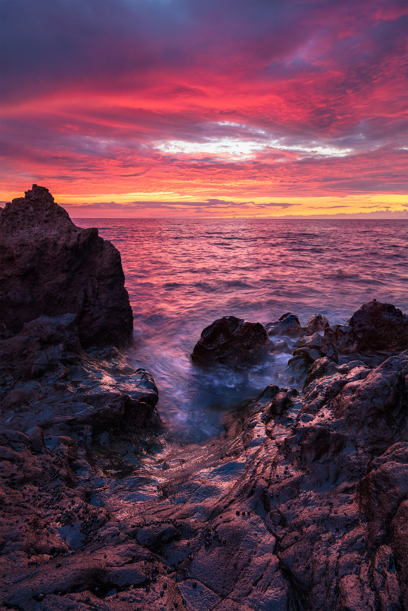 In this photo captured in Waikoloa on the Big Island of Hawaii, an explosion of colors ignited over the ocean. The lava rock...
