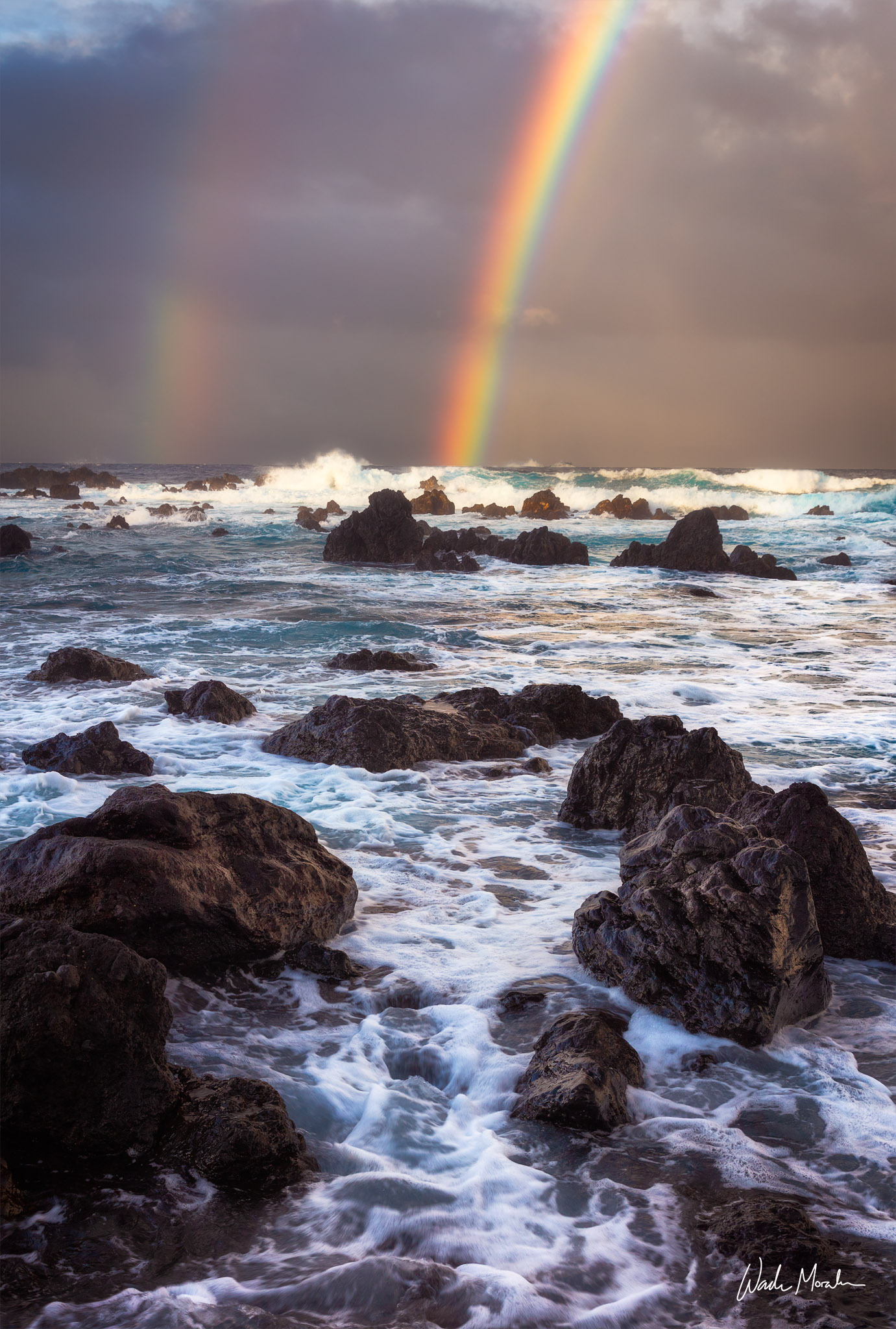 This vibrant rainbow was captured down at Laupahoehoe Point on the Big Island of Hawaii. The waves rushing in over the rocky...