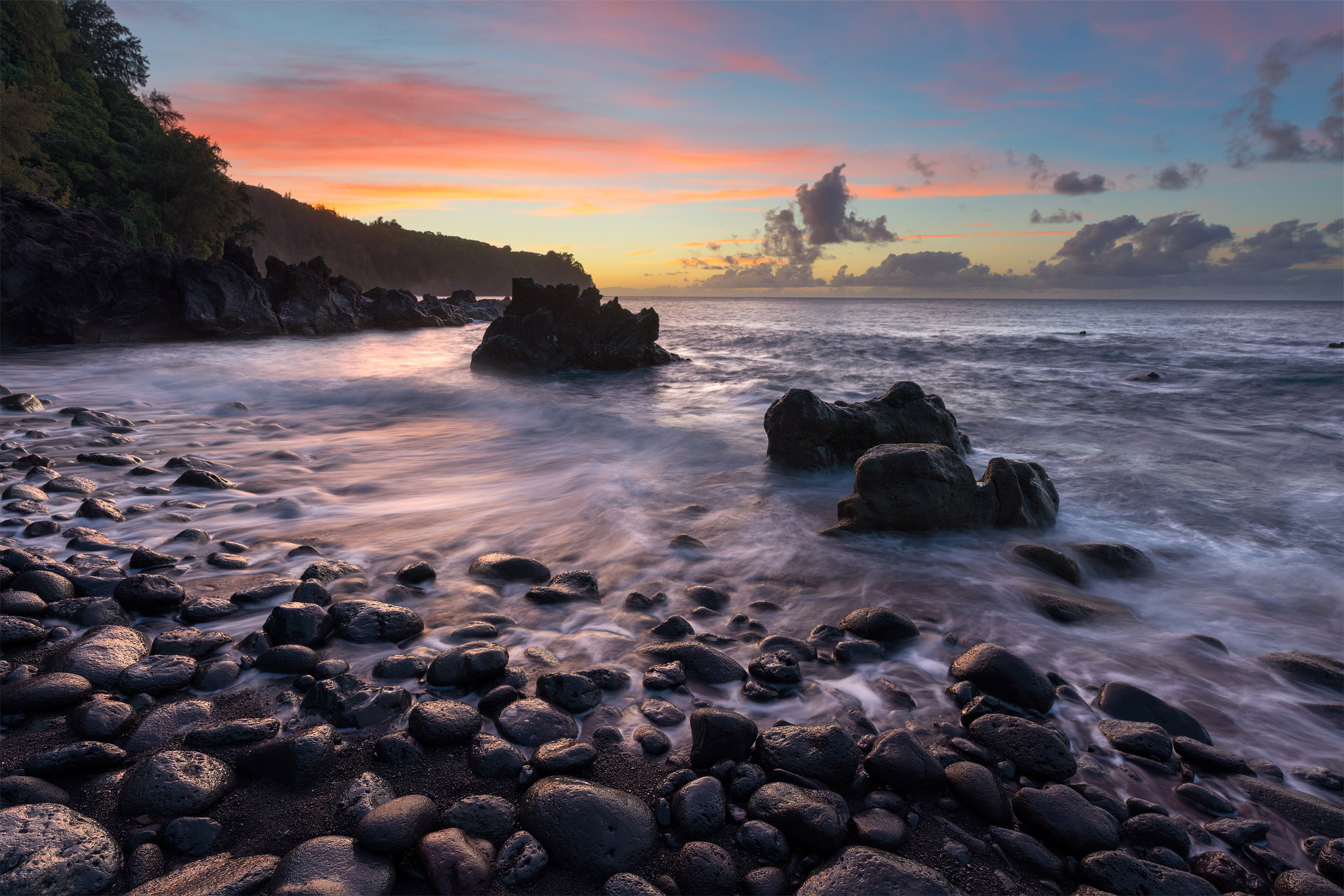 Down in Laupahoehoe, there is a beautiful black sand beach which lies at the mouth of a stream. The beach is covered in river...