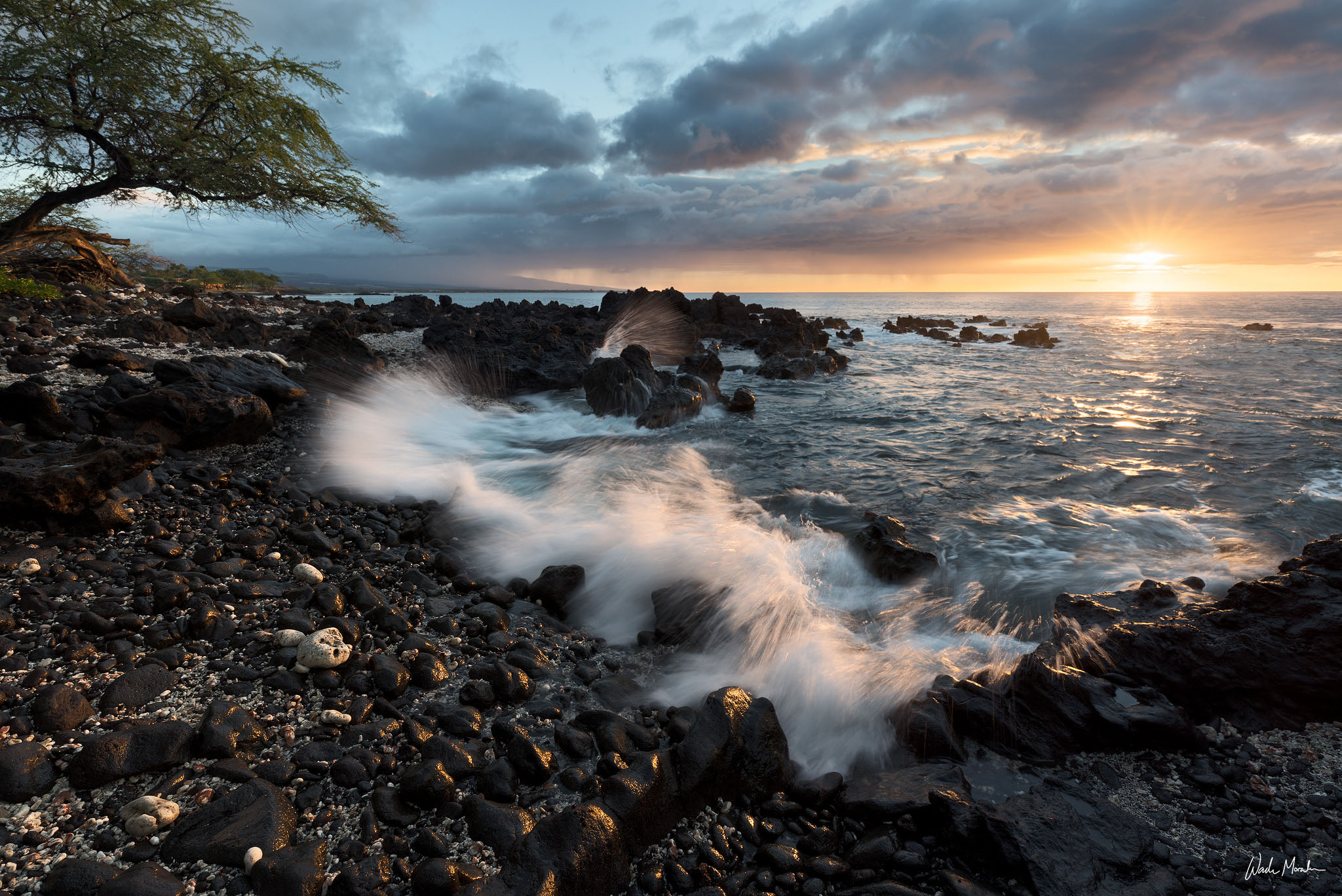 In this photo, I came across a small beach covered in smoothed out lava rocks. The sunlight glowing on the lava rocks, along...