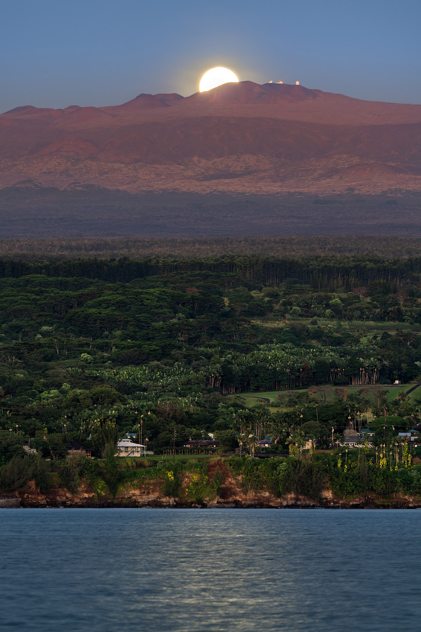 In this image, Mauna Kea is illuminated by a full moon dropping behind the sacred mountain in the early morning. The difficulty...