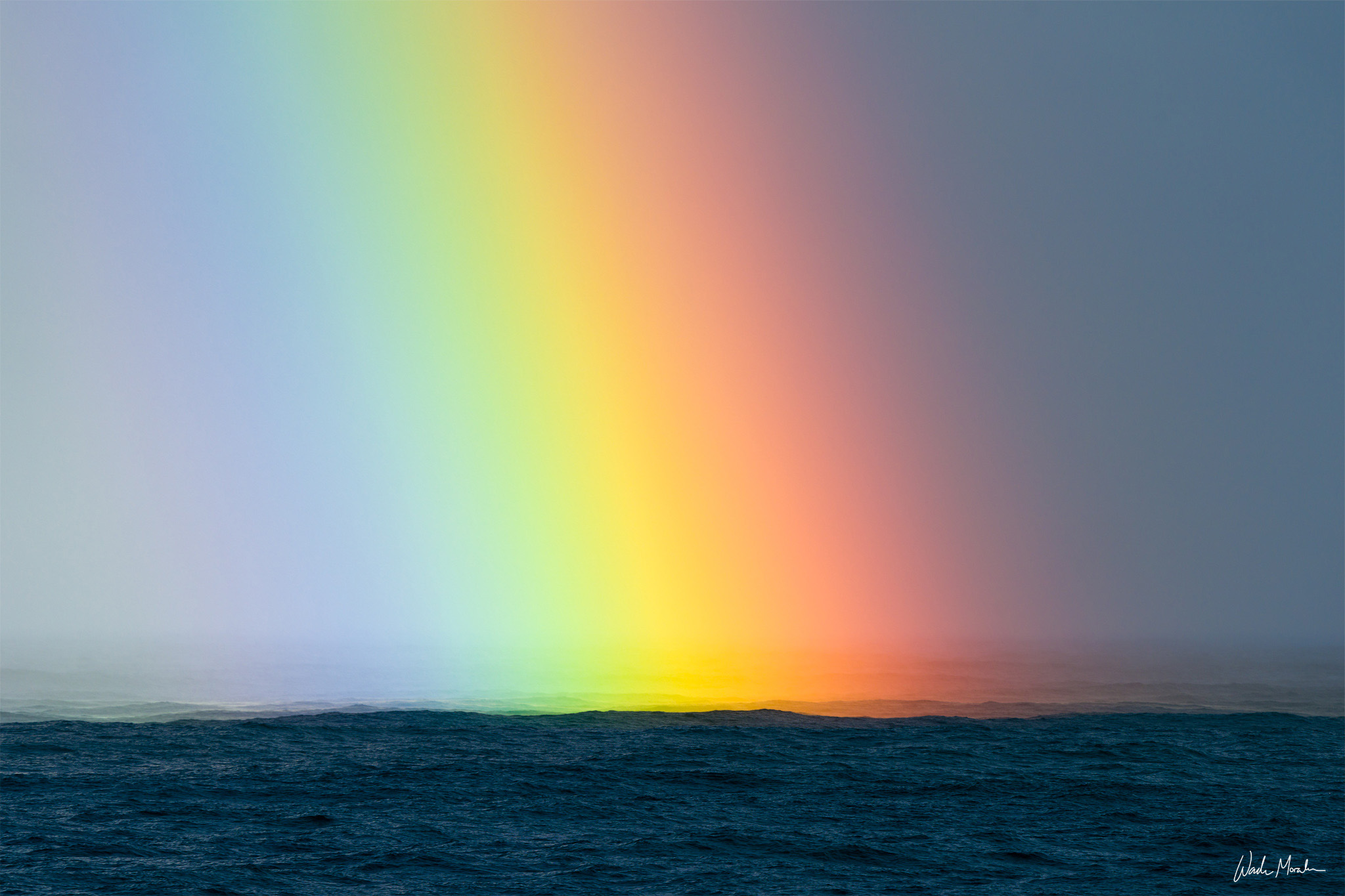 Not far off the coast of Onomea Bay on the Big Island of Hawaii, I took a photo of one of the most vibrant rainbows I have ever...
