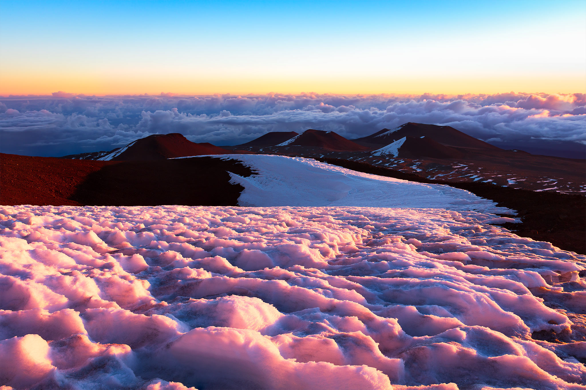 In this photo a blanket of snow and ice is saturated in the morning light during sunrise. The pink color was incredible and short...