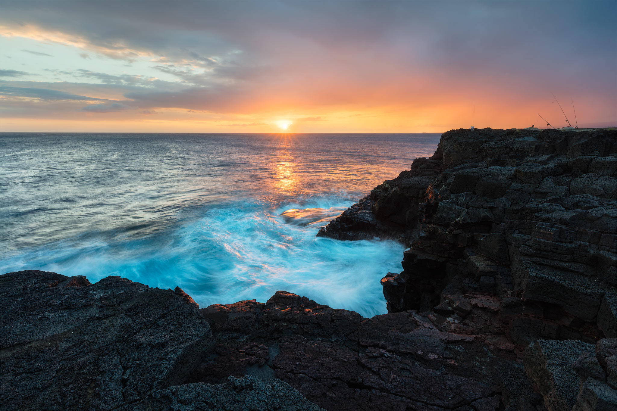 South Point is the most southern part of Big Island, Hawaii and a popular place to fish. In this image, I captured a hazy sunset...